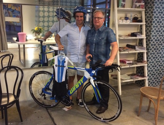 David Nanfra accepts his $5000 prize pack from Leon Nardela of Giant Ormond.